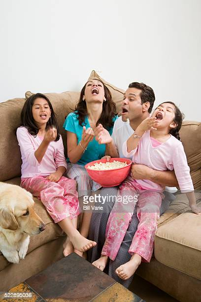 family eating popcorn - dog eats out girl stock pictures, royalty-free photos & images