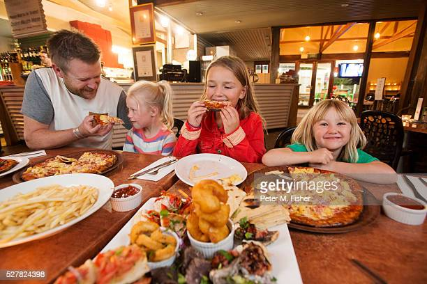 family eating seafood at restaurant - south australia stock pictures, royalty-free photos & images