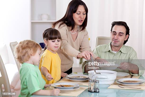 Family eating soup for lunch together