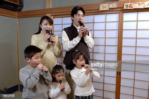 Family eating sushi rolls