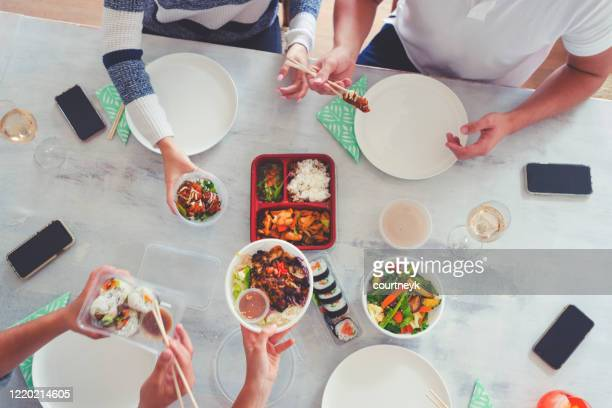 family eating take out food at home. - chinese takeout stock pictures, royalty-free photos & images