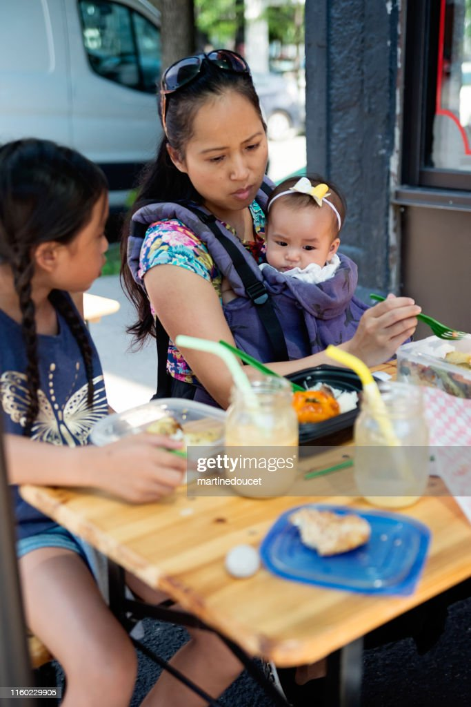 Family eating take out food outdoors. : Stock Photo