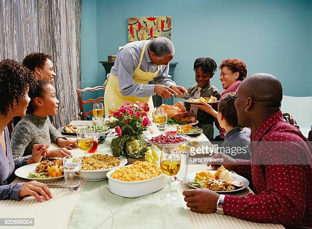 family eating thanksgiving dinner - free thanksgiving stock pictures, royalty-free photos & images