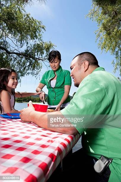 family eating together at picnic - filipino family eating stock pictures, royalty-free photos & images