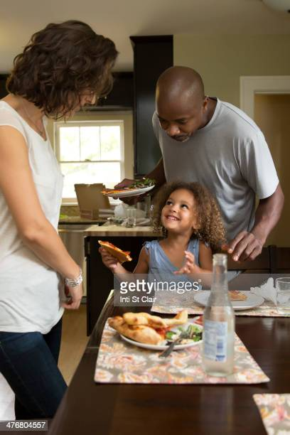 Family eating together at table