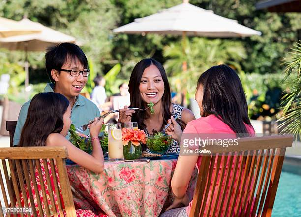 Family eating together on patio