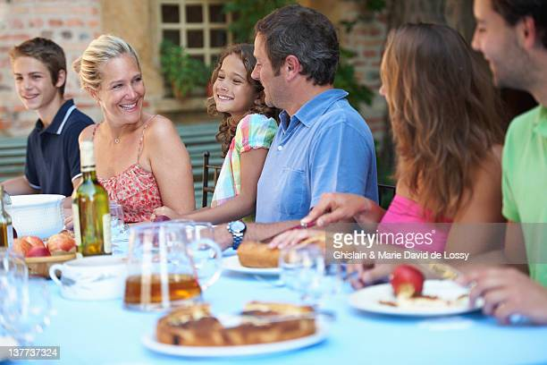 Family eating together outdoors