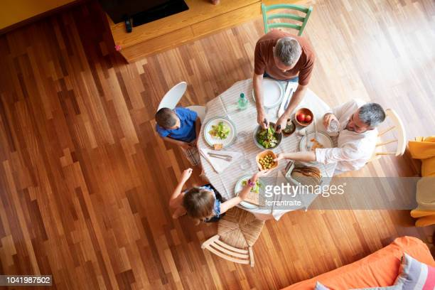 lgbtq family eating together - wooden floor stock pictures, royalty-free photos & images