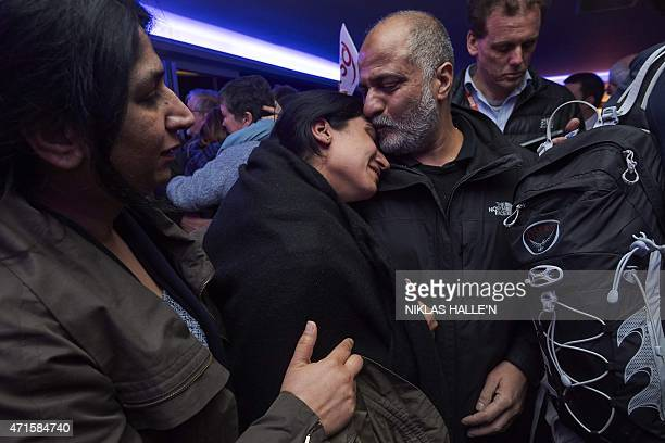 A family embrace as British nationals arrive at London Stansted Airport on April 30 2015 after they were evacuated from Nepal following a 78...