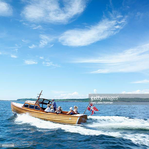 family enjoy cruising on classic wooden boat - norwegian flag stock pictures, royalty-free photos & images