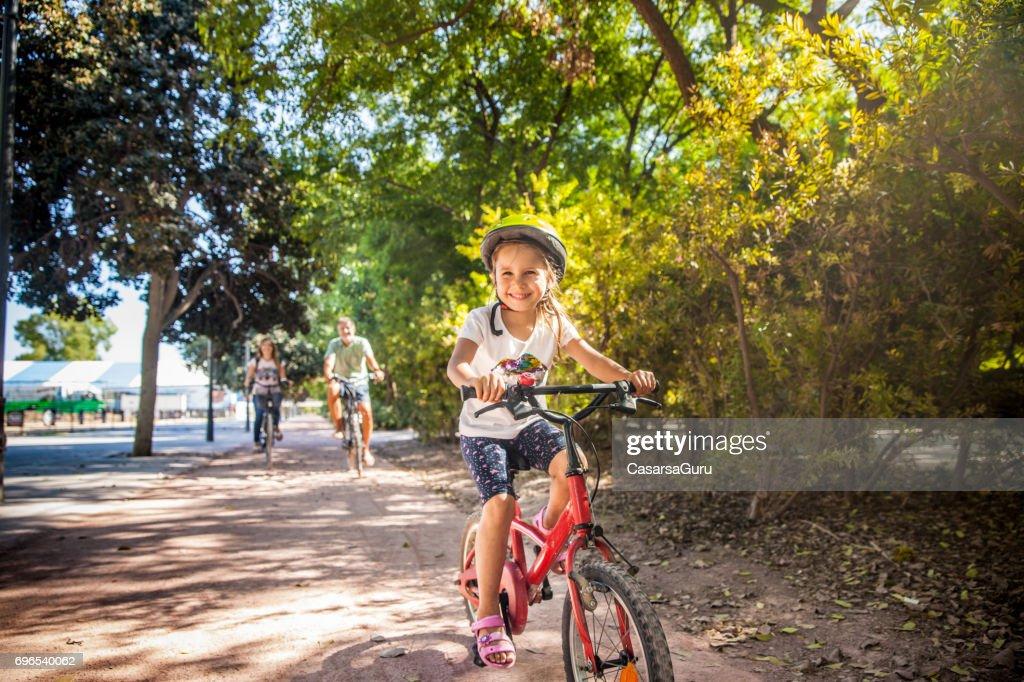 Family Enjoy Cycling On Valencia Cycling Path : Stock Photo