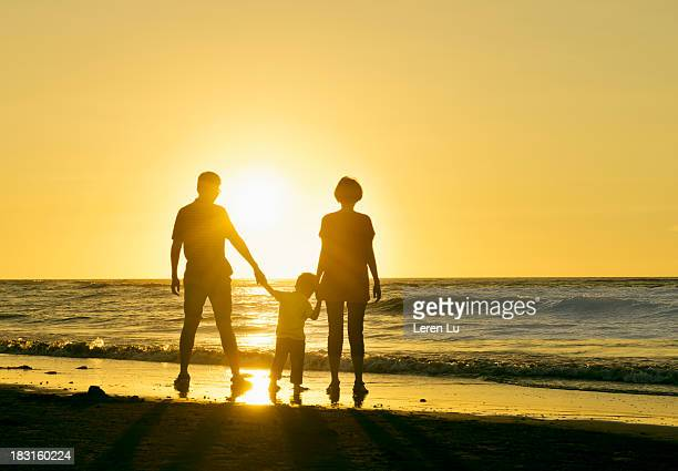 Family enjoy the sunset on beach