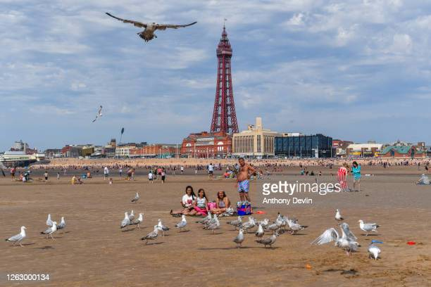 A family enjoy the warm weather on Blackpool beach on July 31 2020 in Blackpool England High temperatures are forecast across the UK today with some...