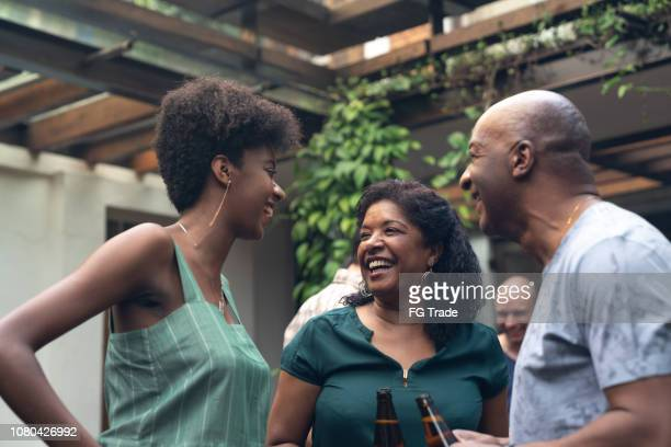 family enjoying a barbecue day at home - african american family home stock photos and pictures