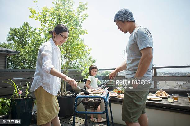 Family enjoying a barbecue on the terrace