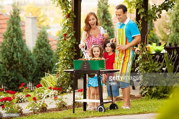 Family Enjoying a barbecue.