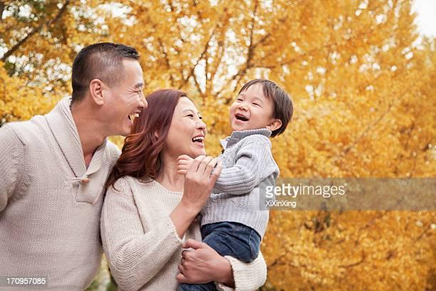 Family Enjoying a Park in Autumn