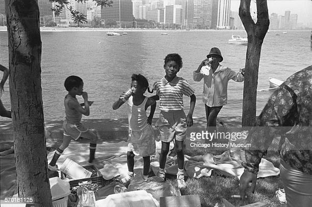 Family enjoying a picnic on the lakefront at Olive Park Chicago Illinois circa 1987