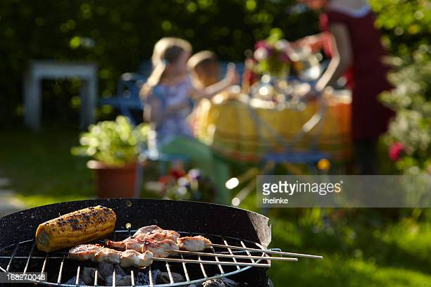 Family enjoying a relaxing summer barbecue party