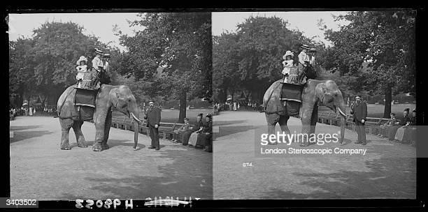 A family enjoying a ride on an elephant at London Zoo in Regent's Park London circa 1895