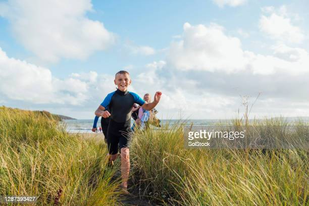 family enjoying a staycation - beach stock pictures, royalty-free photos & images