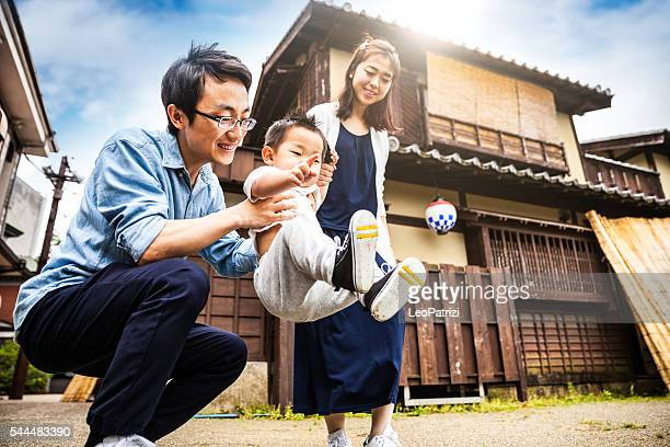 family enjoying a visit to kyoto historical old town, japan - japan mom and son stock photos and pictures