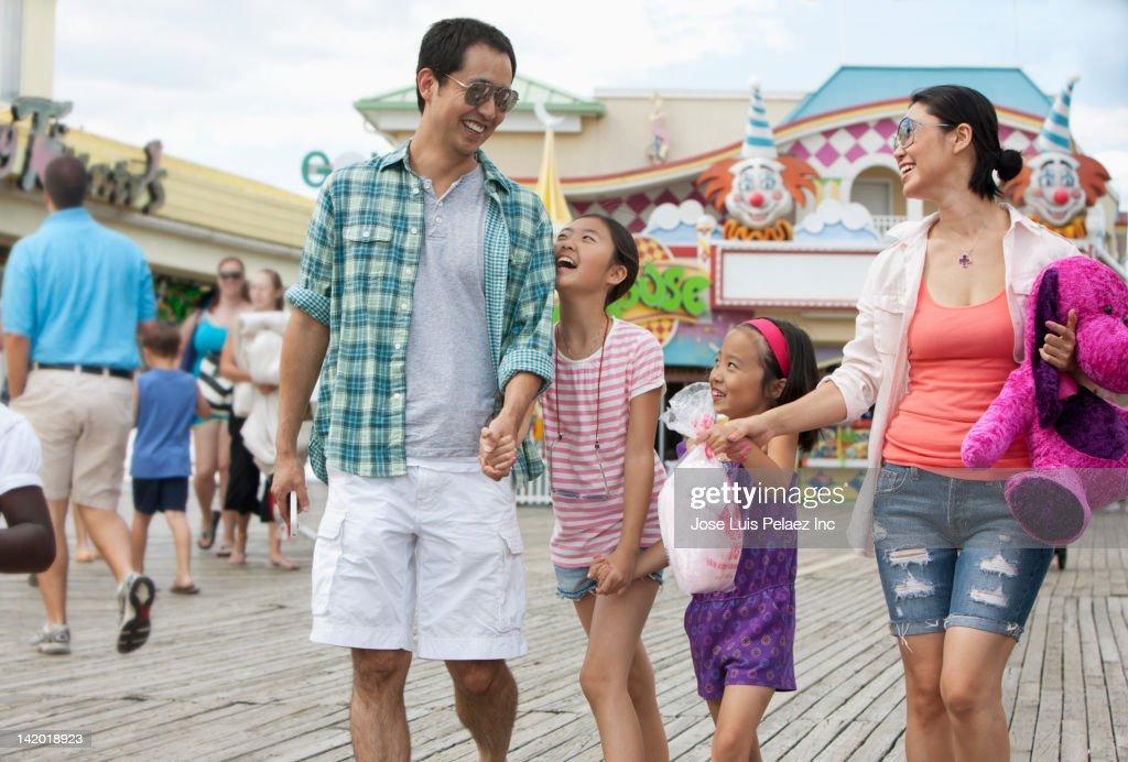 Family enjoying amusement park : Stock Photo
