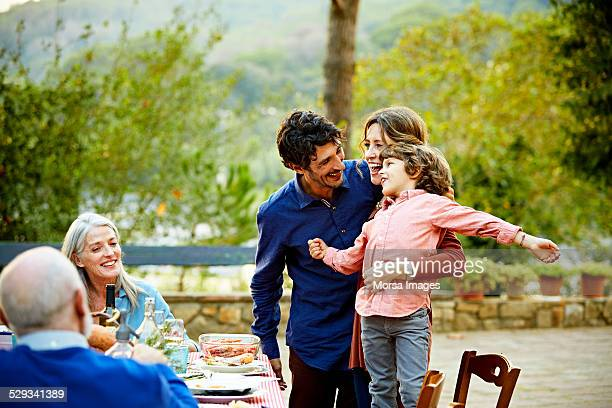 Family enjoying at outdoor meal table