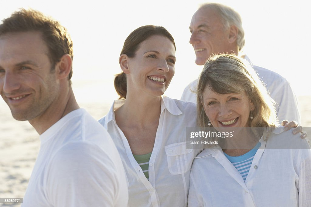Family enjoying beach : Stock Photo