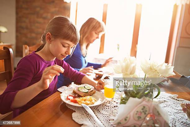 family enjoying beakfast - imgorthand stock photos and pictures