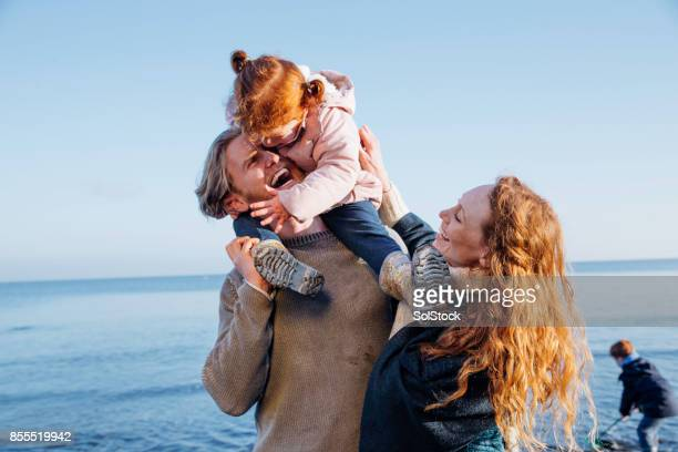 family enjoying being out at the beach - redhead stock pictures, royalty-free photos & images