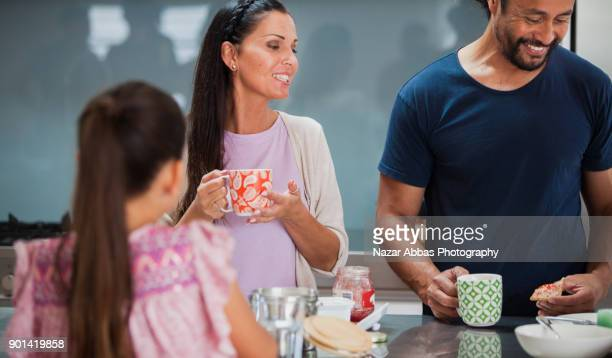 Family enjoying breakfast at home.