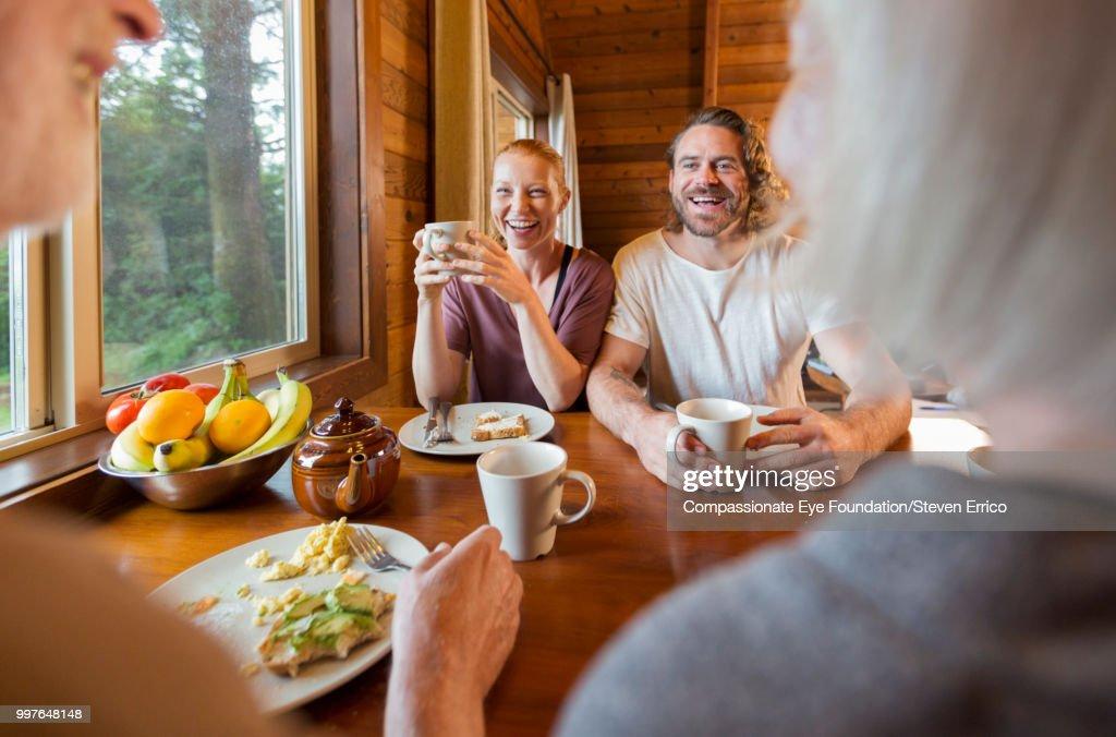 Family enjoying breakfast in cabin : Stock Photo
