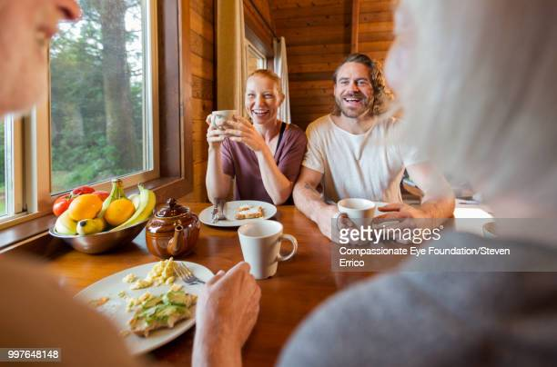 Family enjoying breakfast in cabin