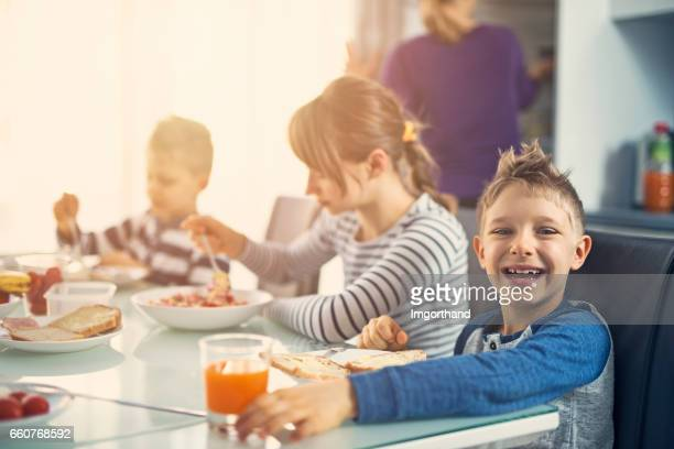 Family enjoying breakfast together on sunny morning