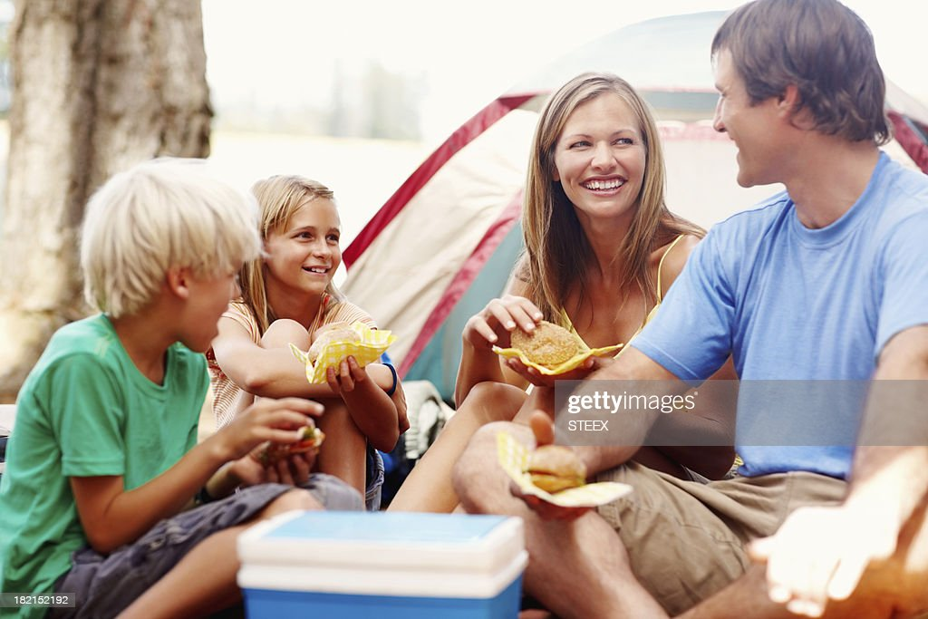 Family enjoying breakfast while camping : Stock Photo