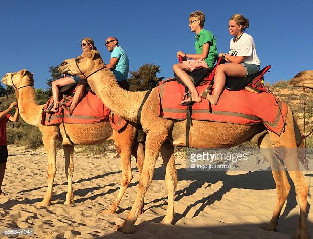 Family enjoying camelride on Cable beach in Broome