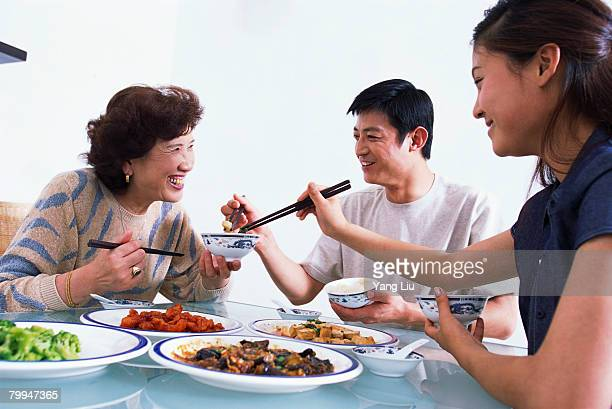 Family Enjoying Chinese Dinner