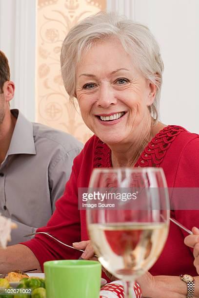 family enjoying christmas dinner - borough of lewisham stock pictures, royalty-free photos & images