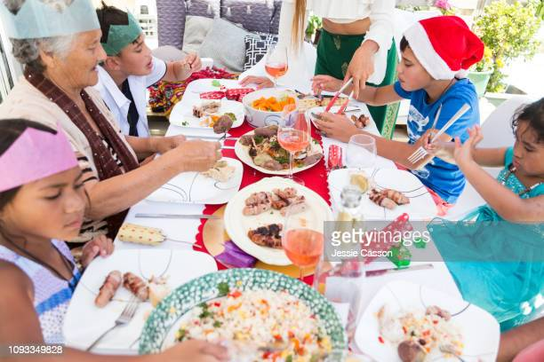 Family enjoying Christmas lunch