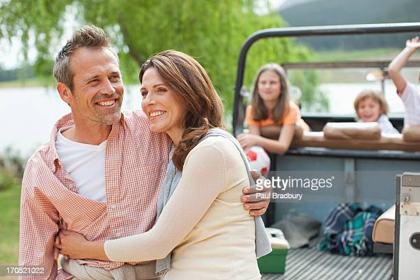 family enjoying day at lake - mid adult stock pictures, royalty-free photos & images