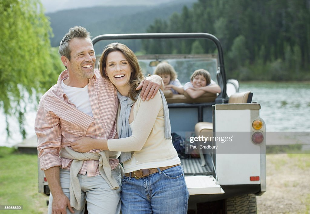 Family enjoying day at lake : Stock Photo