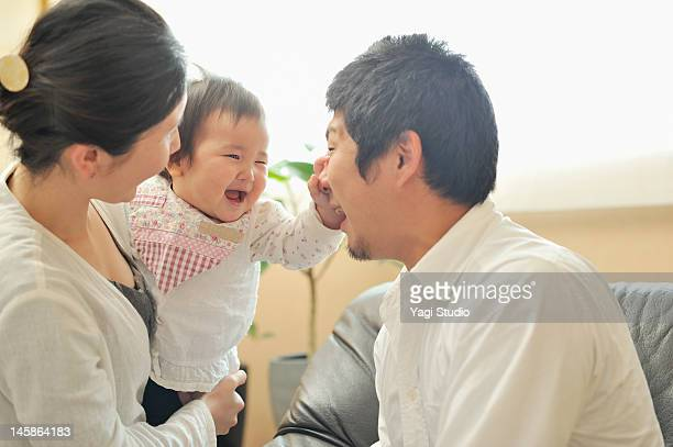 family enjoying day in the room. - far east stock photos and pictures