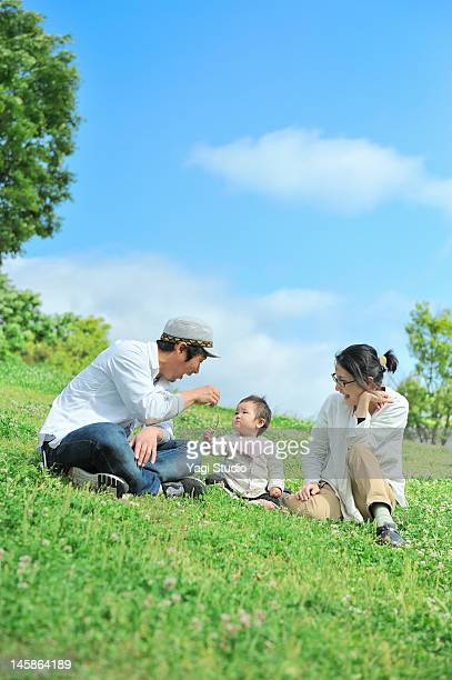 Family enjoying day on the lawn.