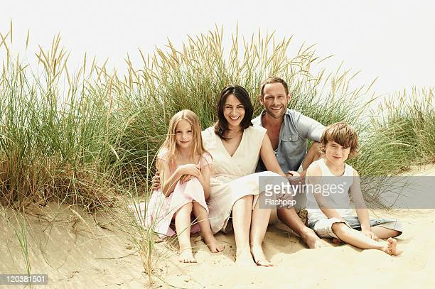 family enjoying day out at the beach - newpremiumuk stock pictures, royalty-free photos & images