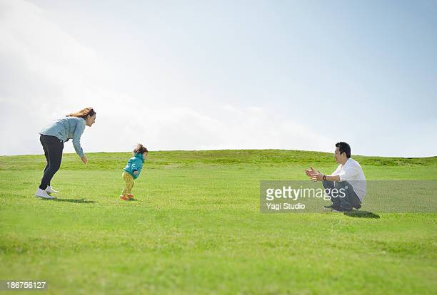 Family enjoying day out in the grass