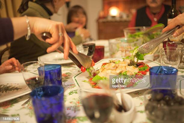 family enjoying dinner - ippei naoi stock photos and pictures