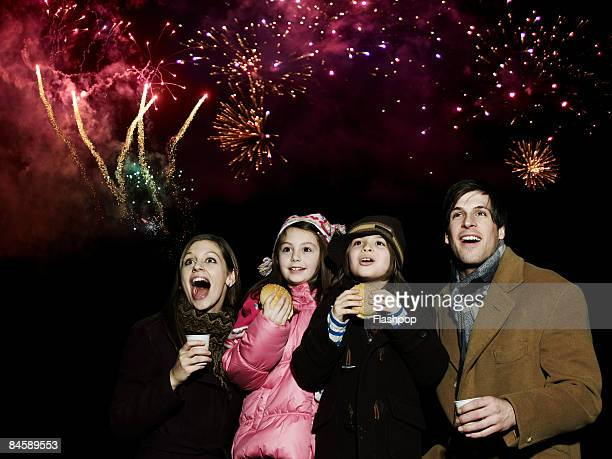 Family enjoying firework display