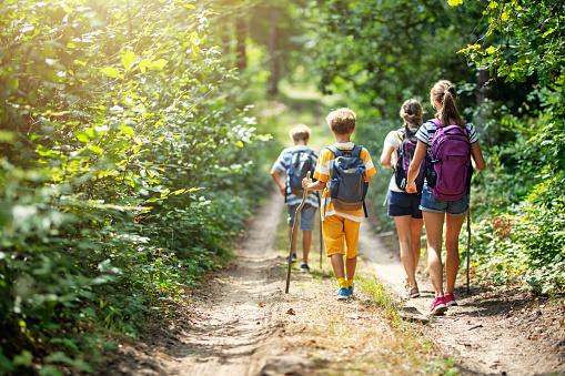 Family enjoying hiking together 1198107702