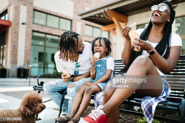 family enjoying ice cream in city of tacoma - tacoma stock pictures, royalty-free photos & images